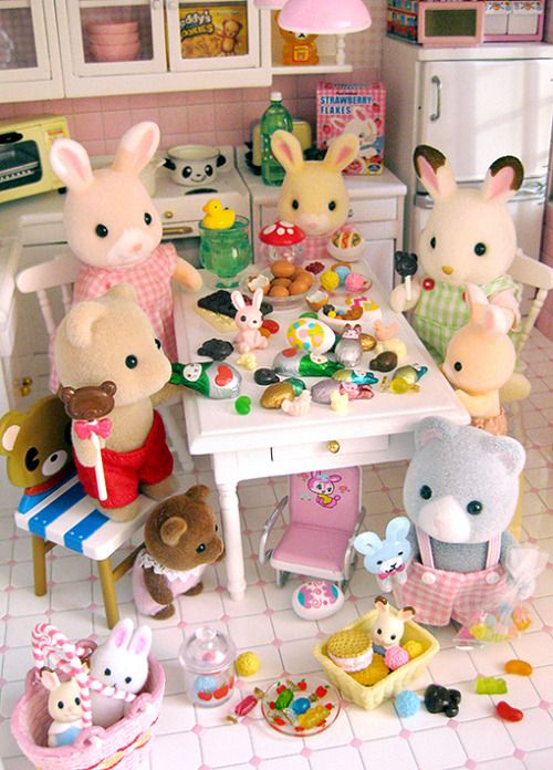 I pinned this just because I want to know what that light tan rabbit with cream tips of ears in the pink dress is