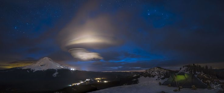 Mt. Hood and a Lenticular Cloud -- Image Credit & Copyright: Ben Canales // The mountain pictured is Mt. Hood located in Oregon. Lenticular clouds can only form when conditions are right (i.e. this is 1st time this astrophotographer has seen a lenticular cloud at night near Mt. Hood).