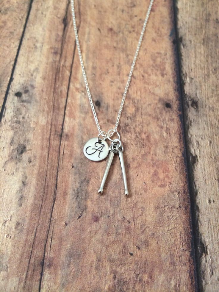 Drum sticks initial necklace - drummer necklace, silver drum sticks necklace, gift for drummer, musician necklace, gift for music teacher by kimsjewelry on Etsy https://www.etsy.com/listing/200780305/drum-sticks-initial-necklace-drummer