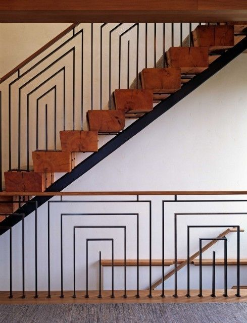 Stairs with geometric pattern railings