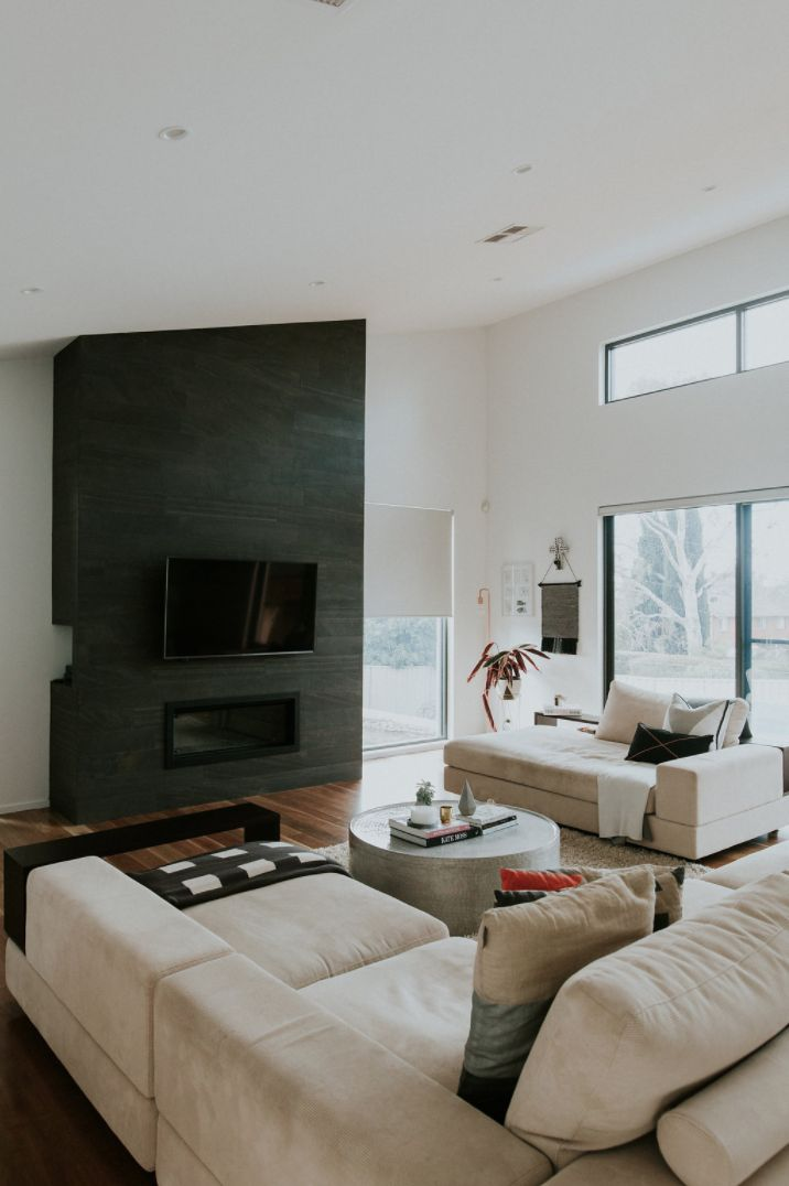 Raked ceiling, full height fireplace and hardwood floors are just some of the features to love in this newly built home.