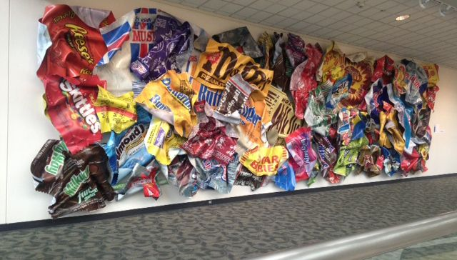 """In DeVos Place, Paul Rousso of Charlotte, N.C. set up """"November 1st"""" -- a 30-foot by 9-foot sculpture resembling various candy bar wrappers"""