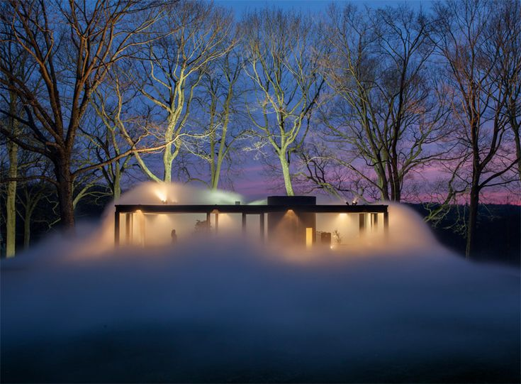 Phillip Johnson's Glass House stages a misty disappearing act.