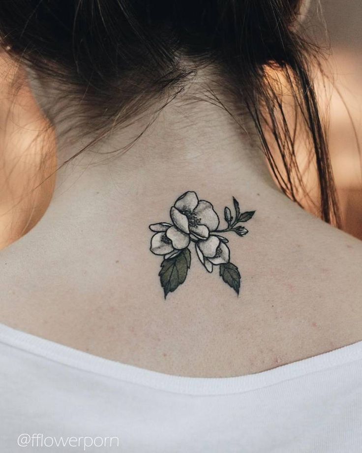 Jasmine tattoo on the back of the neck. Tattoo Artist: Olga Nekrasova