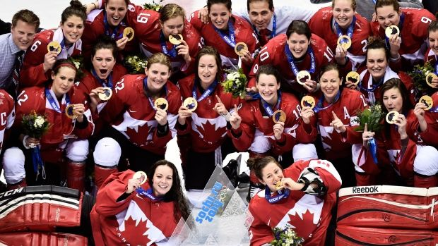 Team Canada poses for a photograph after defeating the United States during sudden death overtime women's hockey final action at the 2014 Sochi Winter Olympics in Sochi, Russia on Thursday, Feb. 20, 2014. (Nathan Denette / THE CANADIAN PRESS)
