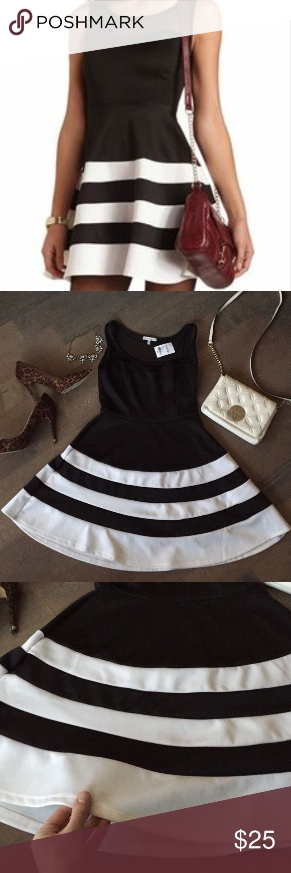 🎄⭐️Sale!⭐️ Black White Striped Dress! BRAND NEW WITH TAGS! ⭐️💕 Gorgeous black and white striped dress! Has sheer neckline and shoulder straps for a flirty look! Perfect for the holidays 🎄🍷⭐️ Size medium. Charlotte Russe Dresses