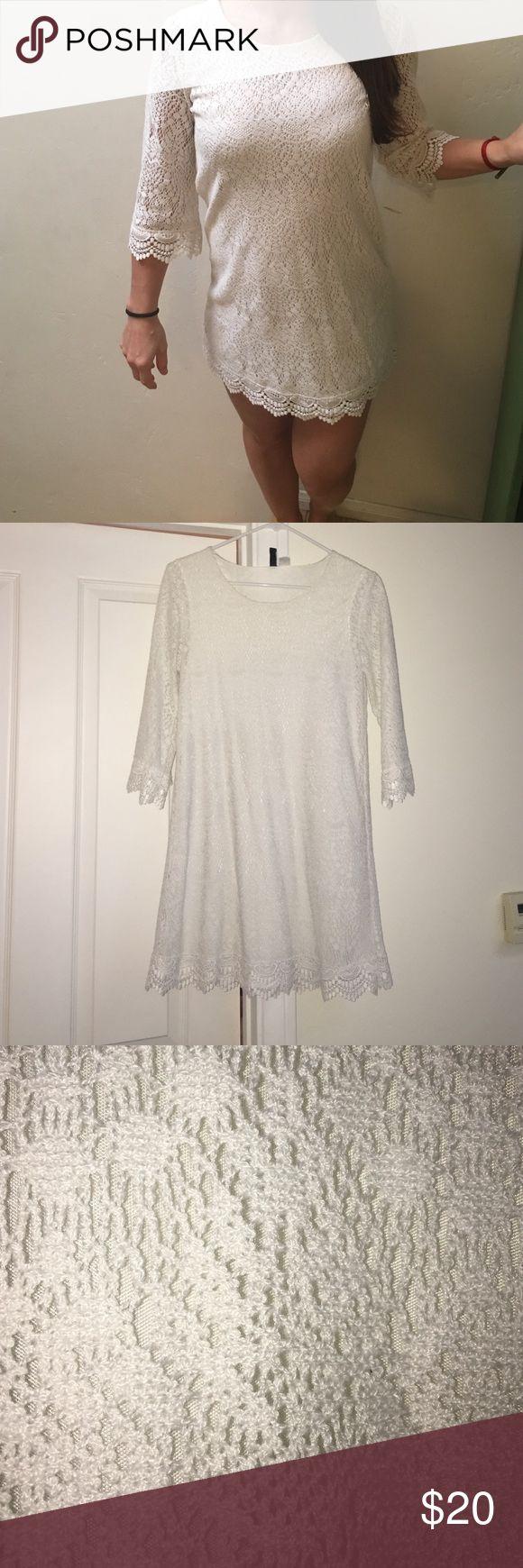 White crochet mini dress 3/4 sleeve white crochet mini dress from H&M. Size 6 US. Super cute alone or with leggings. Worn once. H&M Dresses Mini