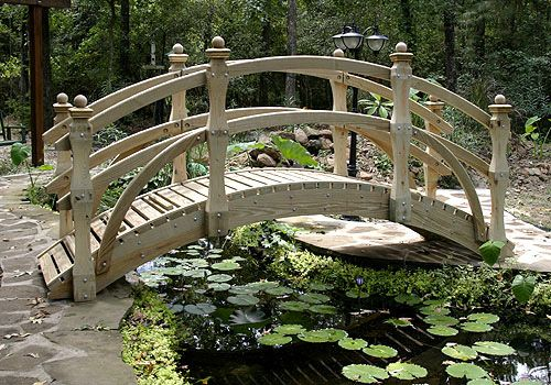 Our ornamental landscape bridges are perfect for spanning a water garden, koi pond, stream, dry bed or your imagination. Uniquely carved posts topped with layered finials add a decorative touch to our spectacular garden bridges