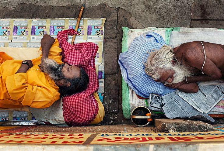 Varanasi, India: Following the completed religious rituals two Sadhus are peacefully sleeping on the shore of the river Ganges in Shiva's sacred town. © Matjaz Krivic