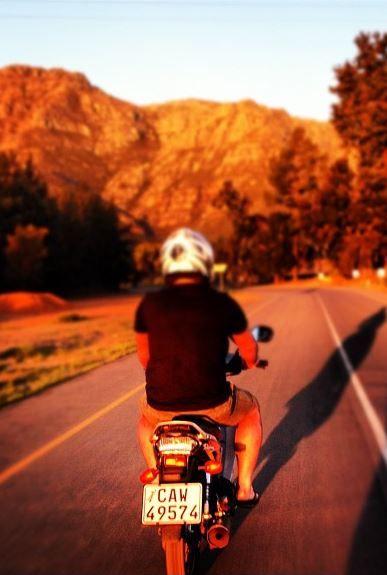 Sunset. Mountains. Motorbike.