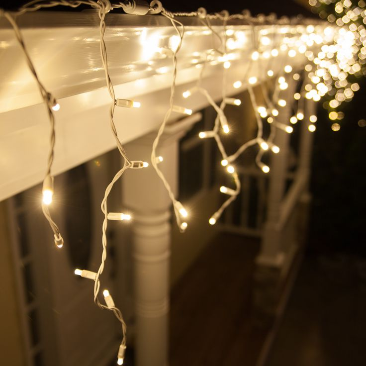 Hang warm white icicle lights outdoors and inside too! So cozy for bedroom accent lighting!