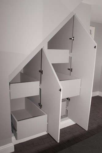 Cabinets with built in drawers under stairs