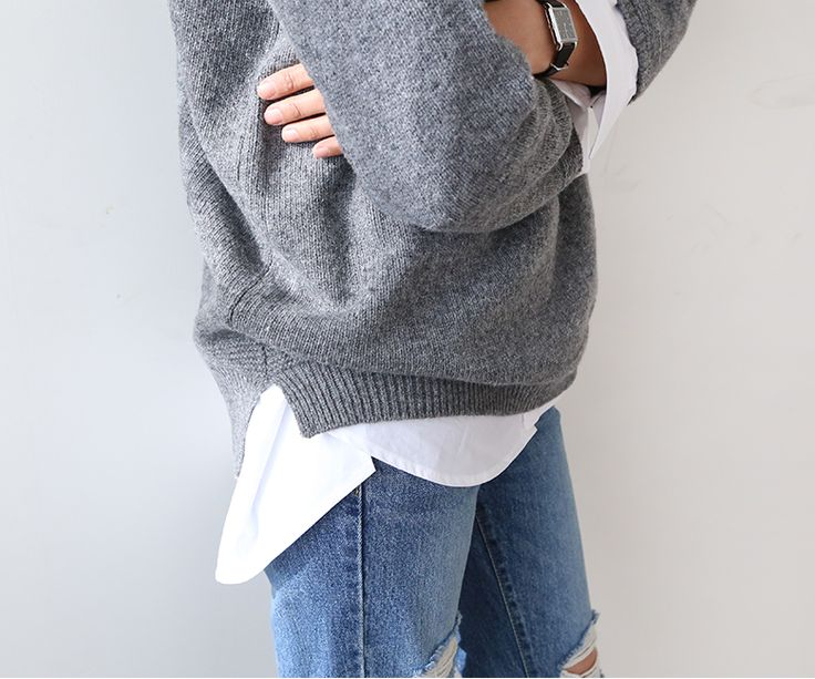 Grey jumper and ripped denim
