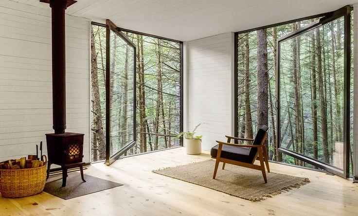 Pivoting windows in treehouse cabin interior