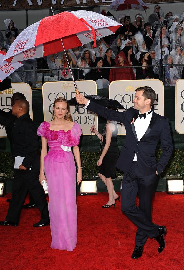 """Buzzfeed: """"Joshua Jackson And Diane Kruger Are The Cutest Couple In Hollywood And That's A Fact"""" ... I'll go with the best dressed pair for now. Also, Joshua Jackson is clearly the best boyfriend/umbrella holder."""