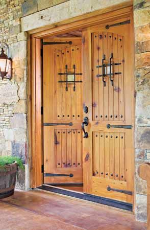 For a dramatic entry, the massive doors lead into the Fewoxes' renovated barn retreat. Heavy iron hardware adds to the handcrafted feel.0