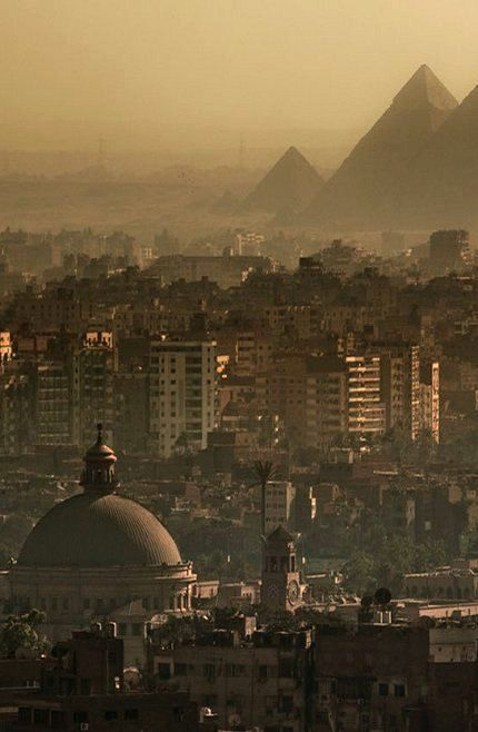The Great Pyramids in Cairo, Egypt. The dome in the foreground is that of Cairo University.