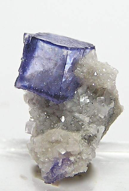 Fluorite on Dolomite, the most beautiful Fluorite is located in Illinois , Dolomite is prevalent in Missouri. The combination of the two is a beautiful connection. Dolomite adores Fluorite .