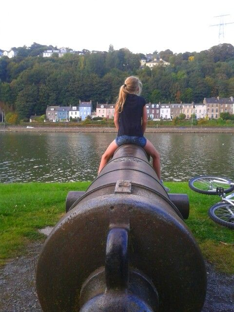 Old British cannon, pointing across the river Lee towards Tivoli.  The marina. Cork city