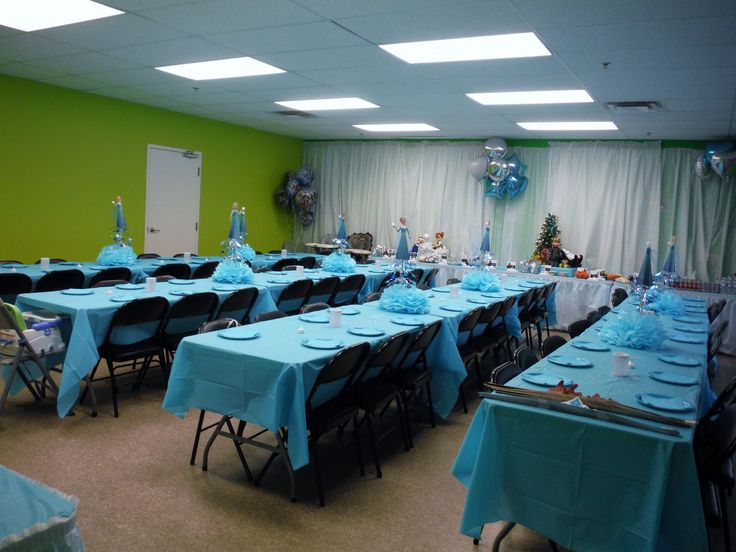 Frozen decoration. Dollarstore table cloths used for white backdrop. We used poster-tape to stick the tables to the walls (easily removable without damage to walls)