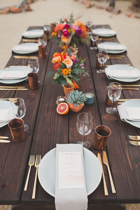 Wood head table with orange and pink flowers in gold containers. Add in white pumpkins and gold lanterns - remove grapefruit :)