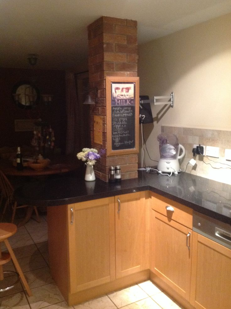 Black granite worktop and stone effect tiles.  Granite Transformations