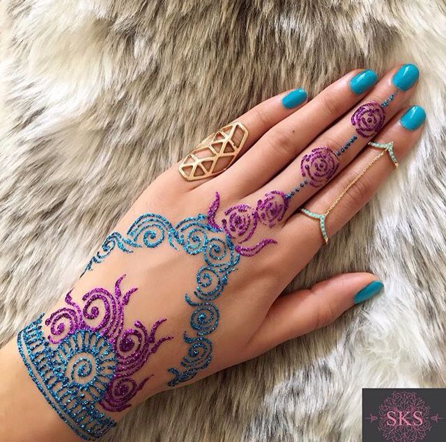 Love the colorful glittery henna!!