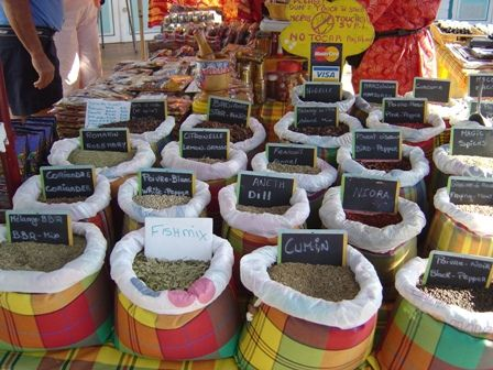 """Spices from Guadeloupe shown in beautiful cloth sacs made from traditional """"antillaise"""" fabric."""