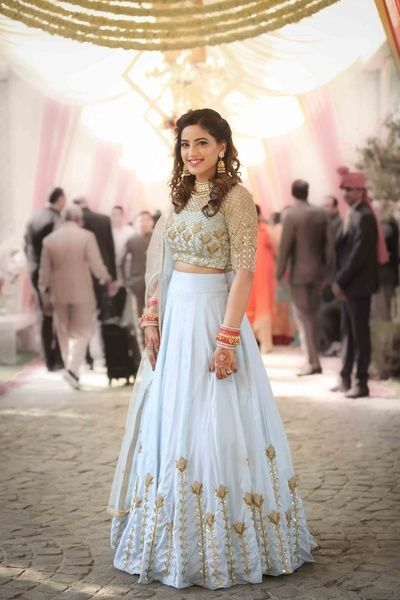 Light Lehengas - Sky Blue Lehenga with Gold Embroidery | WedMeGood | Sheer Embroidered Gold Blouse with High Waisted Lehenga and Gold Flowers #wedmegood #indianbride #indianwedding #lightlehengas #sisterofthebrideoutfit #sisterofthebride #lehenga #aqua