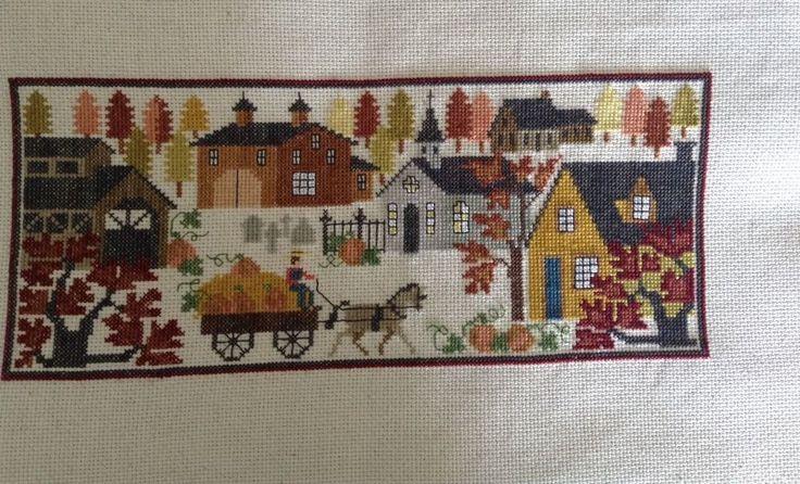 completed cross stitch Prairie Schooler Thanksgiving pumpkins sampler