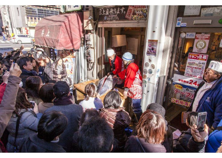 The Tuna Cutting Show, held in one of Tsukiji Market's Atmospheric Alleys, Tokyo, Japan