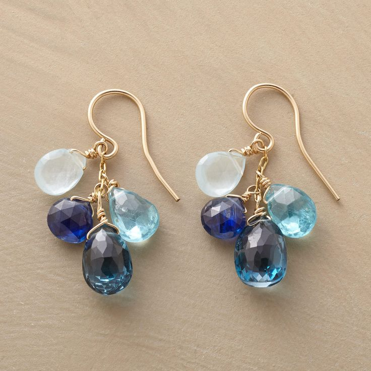 """SEVENTH SEA EARRINGS--A pair of Thoi Vo blue gemstone earrings, in which faceted briolettes in oceanic hues drip from twists of 14kt goldfill. Handmade in USA with kyanite, London blue topaz, aquamarine and apatite. 1-1/8""""L."""