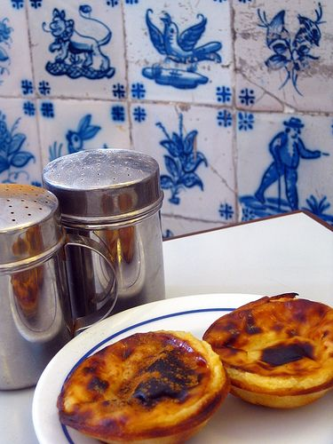 Eat your custard tarts here! The interior of the Pastéis de Belém cake shop and café is covered with azulejos. Lisbon