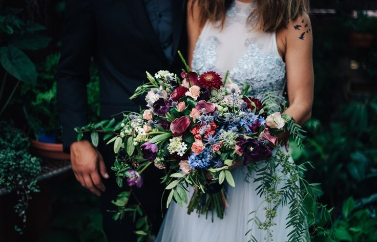 Woods & Bloom created this bouquet for the Reverie inspiration shoot. Hauntingly beautiful jewel tones in the blooms  create a wild bohemian feel