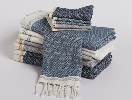 Use Coyuchi's Mediterranean Bath Collection towels to dry off. Traditional lightweight Turkish bath towels with a high/low weave for excellent absorption. Woven from yarn dyed 100% organic cotton and edged in hand-knotted fringe.