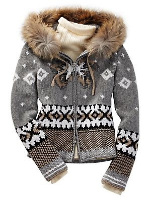 An adorable hooded winter sweater. It would be perfect is the fur was faux.