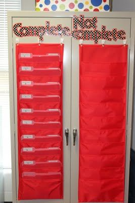 LOVE THIS!  I always struggle with how to manage this without clutter while maintaining the 'visual' of 'you have stuff to do, kiddo!'... Love this simple!!  Need those pocket charts in blue or green for class theme!