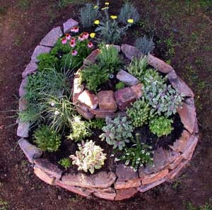 permaculture design for a garden bed with flowers and herbs