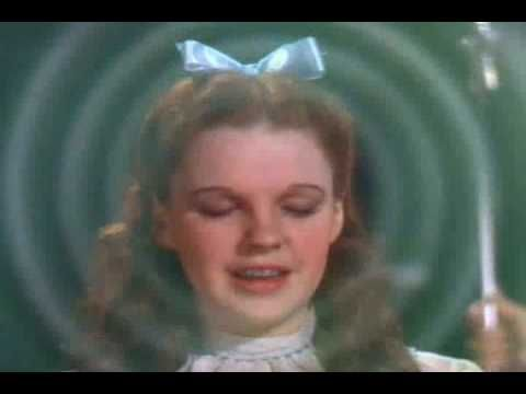 """Dorothy performs Glinda the Good Witch's simple magic spell: all she has to do is click the heels of her magic shoes and repeat, """"There's no place like home, there's no place like home..."""" From """"The Wizard of Oz,"""" 1939. http://www.markarcana.com"""