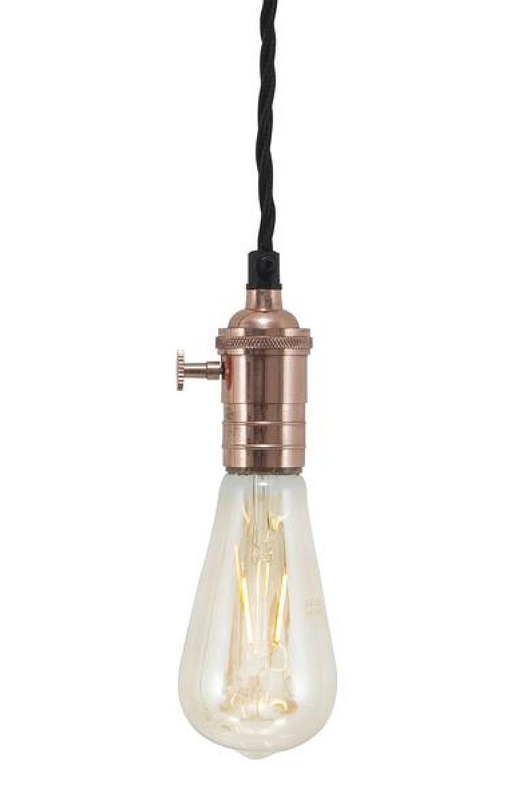 Hung individually or in clusters, these bare bulbs soften harsh textures like concrete and metal
