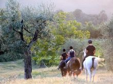 A relaxing riding out at sunset at Il Paretaio in Tuscany.