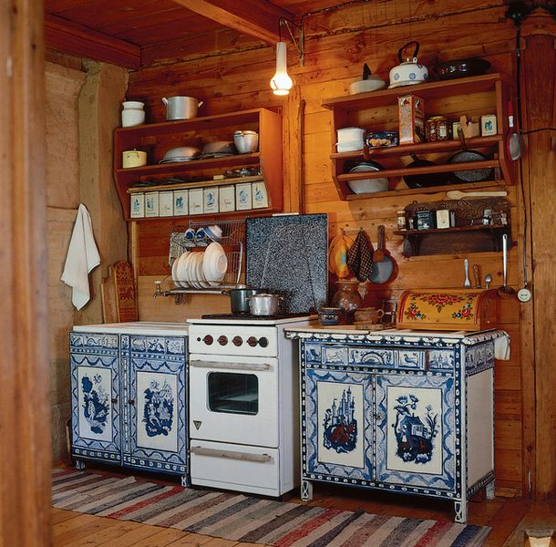 All kitchens do not have to look alike.  Such a quaint little kitchen/painted cabinets.