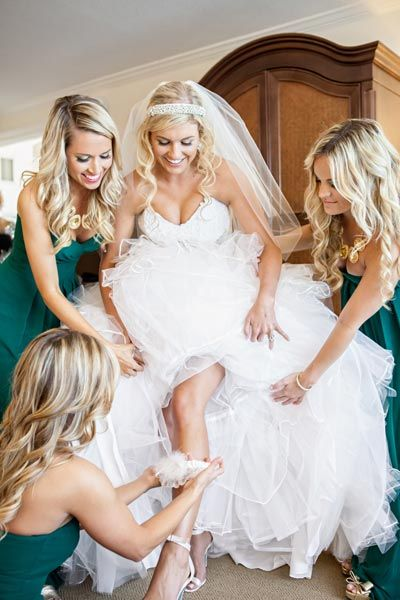 Sliding on the garter can be a little difficult if you have to battle a lot of tulle, but that's what your posse is for.Related:40  Ideas for Your Garter Toss Song