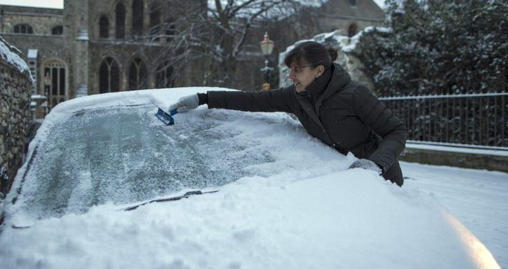 ROCHESTER, UNITED KINGDOM - FEBRUARY 27: A woman scrapes ice from her car on February 27, 2018 in Rochester, United Kingdom. Freezing weather conditions dubbed the 'Beast from the East' brings snow and sub-zero temperatures to the UK. (Photo by Dan Kitwood/Getty Images)