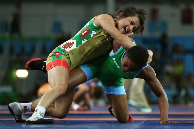 Elitsa Atanasova Yankova (L) of Bulgaria competes against Rebecca Ndolo Muambo of Cameroon during a Women's Freestyle 48kg Classification bout on Day 12 of the Rio 2016 Olympic Games at Caioca Arena 2 on August 17, 2016 in Rio de Janeiro, Brazil.