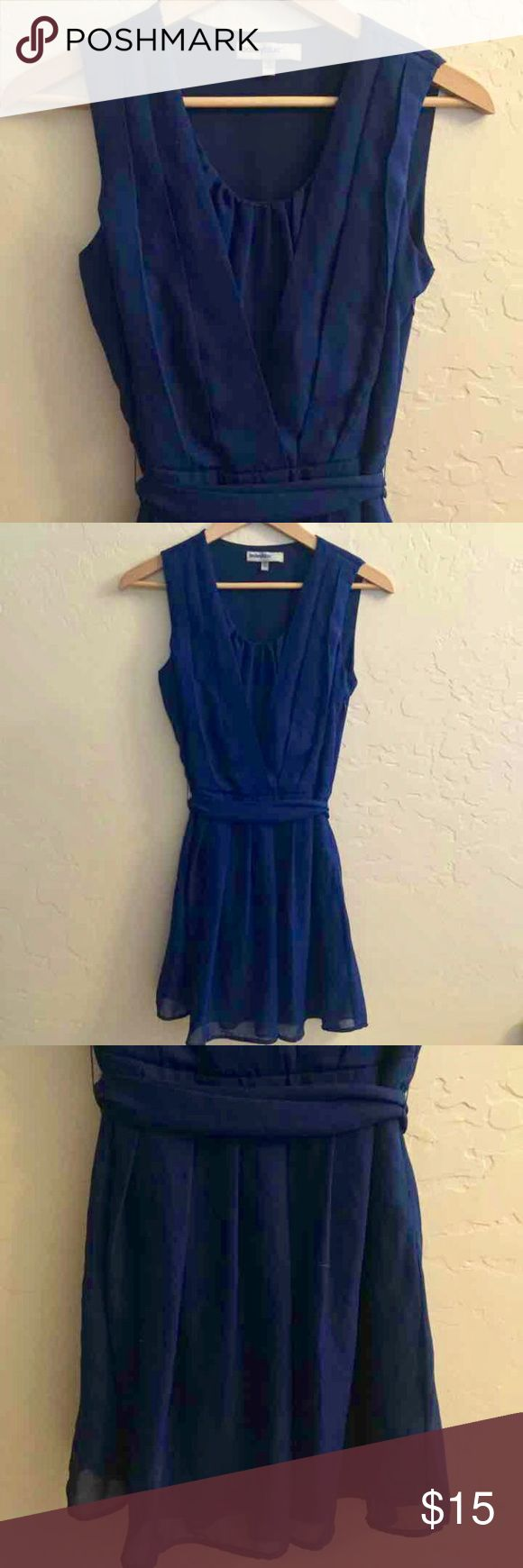 Beautiful Flowy Navy Chiffon Dress! Mid-length, tie waist, navy chiffon dress. Hangs beautifully. Great cut and gathers on the top flow into a beautiful skirt. Beautiful color on anyone! I lightened up the first few pics to show details. Color is closest to last pic. Dresses Midi