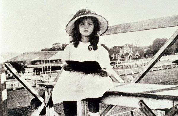 This is 5-year-old Vivian Mary Hartley, aka movie star Vivien Leigh, reading a book at the Bangalore Racetrack, in Bangalore, India, circa 1918.