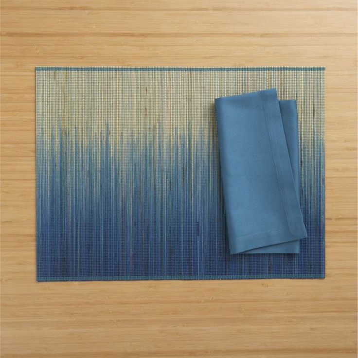 """Oxley Blue Placemat and Fete Corsair Cotton Napkin 