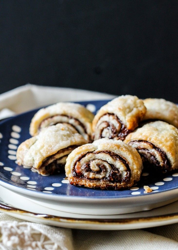 These flaky, melt-in-your-mouth Nutella Raspberry Rugelach are almost too easy to eat - they'll disappear before your eyes! They also keep incredibly well in the freezer.