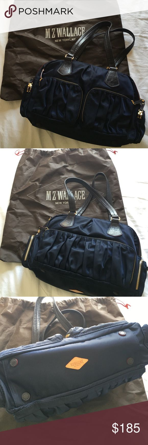 M Z Wallace New York Navy shoulder bag Wore it only couple times. Dust bag and small pouch are included. Crafted of soft nylon with ruched pockets and contrast-edge leather trim. Stylish yet functional. Although I only wore it couple times, a small pouch lining has signs of wear (last picture) But overall excellent condition. From pet free + non-smoking house. No trade please. MZ Wallace Bags Shoulder Bags